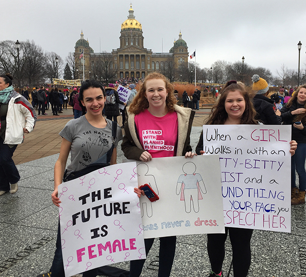 Tara Djukanovic '17, Addi Seybert '17 and Becca Swanson '17 march at the Iowa Capitol building in Des Moines Jan. 21. The Women's March took place at locations across the country to advocate for women's rights.