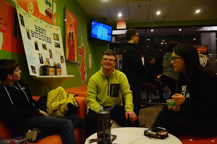 Jared Peterson '17 (left), John Kyhl '(center), and Alyssa Noe '17 (right), hang out at Orange Leaf to raise money for Best Buddies. The fundraiser took place Jan 31.