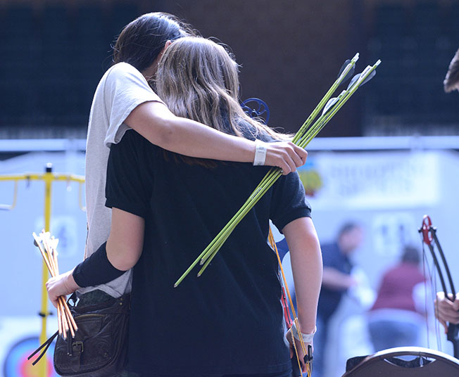 Josie Lies '18 and Shabana Gupta '18, hug after the final round. The archery team ranked 13 out of 23 teams.