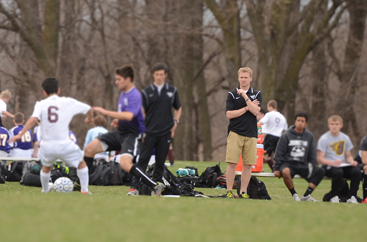 Mead watches a varsity boys' soccer game against Des Moines Lincoln in 2015.