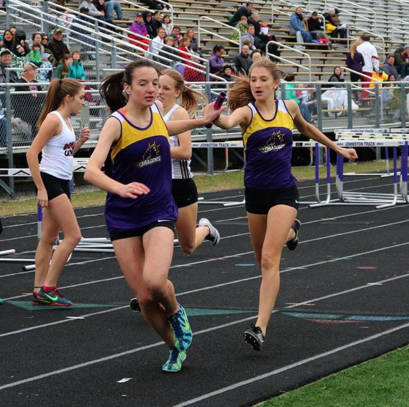 Brooke Mckee '20 hands off the baton to Taryn Swaim '18, the team finished first in the 4 by 800m relay. The girls track team competed at home on March 28.