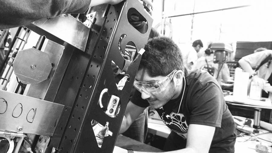 Working on FRC Team 4646's robot, Afshan Chandani '17 rewires an ultrasonic sensor. The robotics team was not a school sponsored activity, though many students competed on a team.