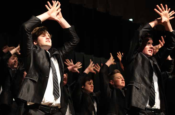 Cole Valentine '17 and Trent Wignall '17 cross their arms in the air during Innovation's male song, Let Me In. Let Me In was a song originally performed by Caleb Johnson.