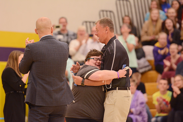 Becky+Scoles+hugs+athletic+director+Gary+Ross.+Scoles+was+recognized+for+her+achievements+in+the+special+olympics.