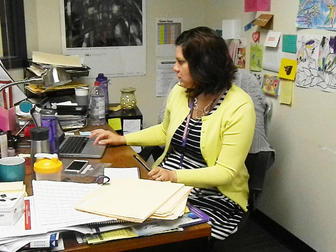 Jill Versteeg checks her computer.