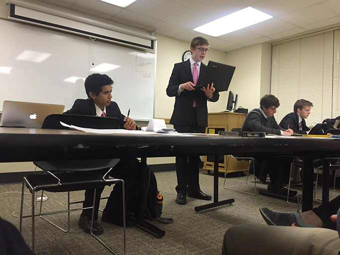 Prakhyath Bujimalla and Jack Lucas '18 debate in the semifinals t the Iowa State tournament.
