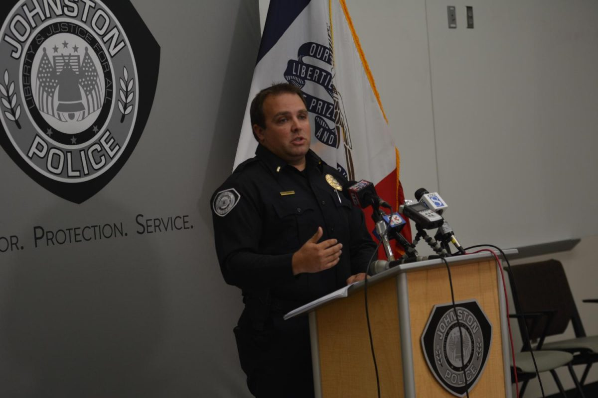 Lt. Tyler Tompkins of the Johnston Police Department speaks to reporters at the press conference regarding the recent arrest of four Johnston students Sept. 28, 2017. The four students were each charged with one count of robbery, one count of sexual abuse second degree and one count of felony assault on a juvenile.