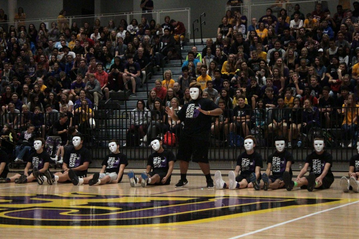 Tahj Neely '18 leads the co-ed dance at the homecoming assembly. Each girl on the dance team selects a guy to preform.