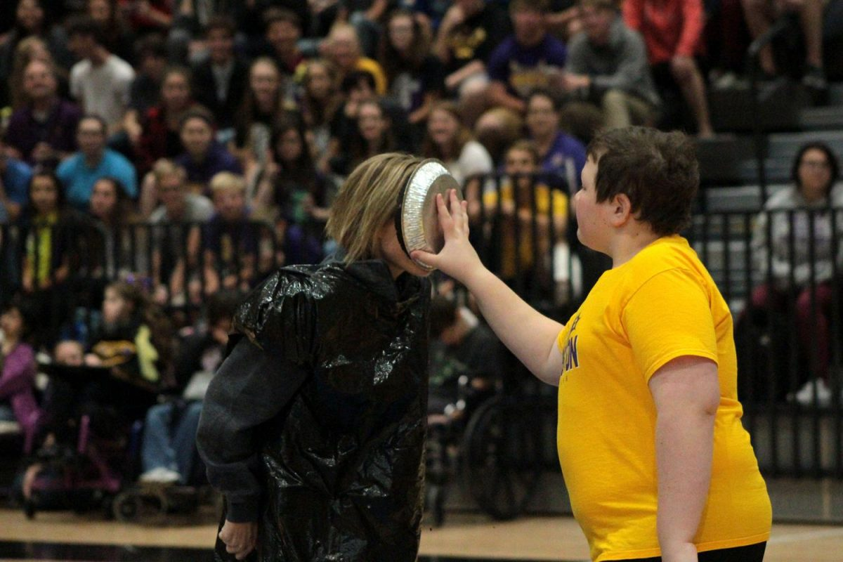 Choir teacher Samantha Robilliard takes a pie to the face from Jack Marren '18. The money that nominated Robilliard went to supporting best buddies.