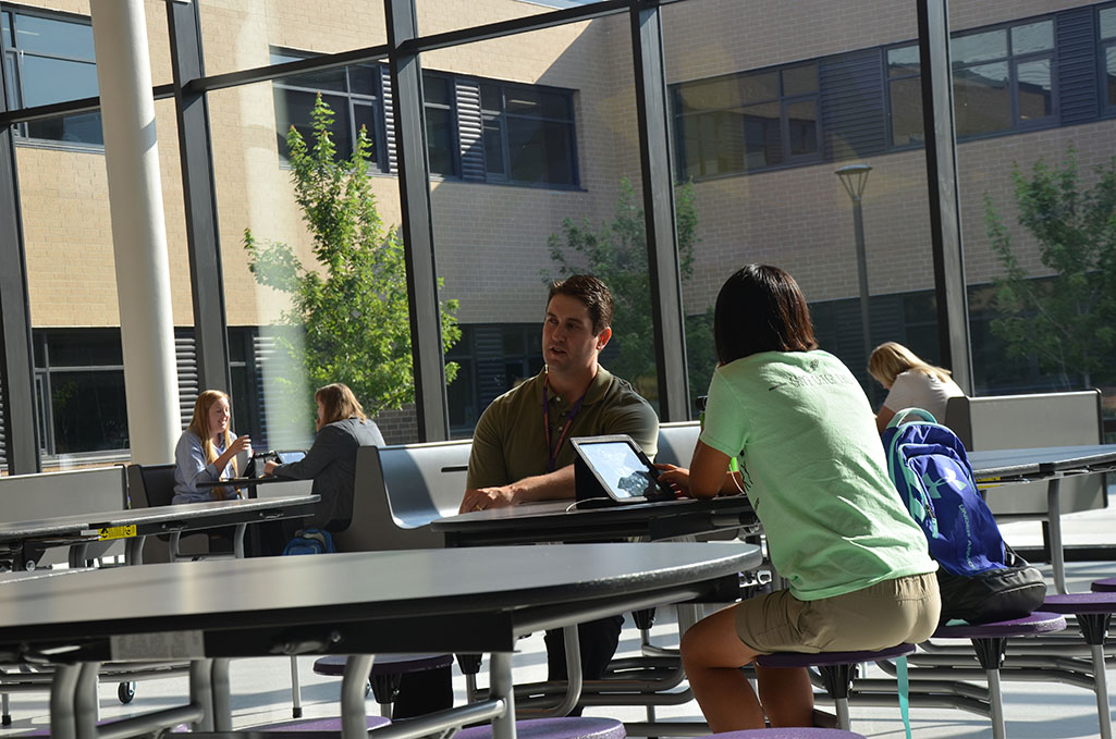 Eric Irwin talks to Natalie Lloyd, '17. Irwin makes it his goal to converse with and connect with students during his down time.