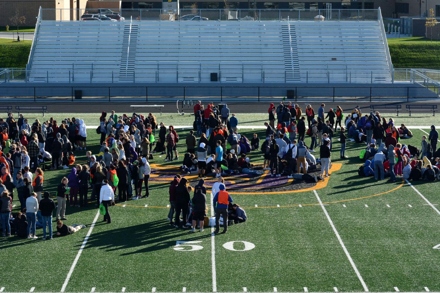 Students huddle during the fire drill. The drill was conducted during 40 degree weather with 25 miles-per-hour winds.