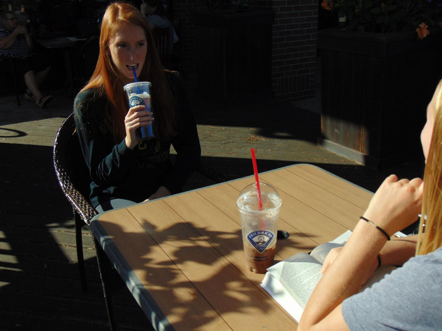 Sloane Wilhelm, '19, Macy Thompson, '19, have their usual coffee at Friedrich's Coffee in Urbandale. This is their go-to coffee shop because of the free wifi and cozy environment.