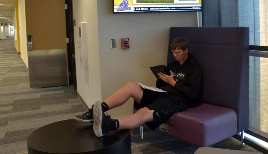 Zach Edmondson, '20, sits in the upstairs commons. In the middle of class working on homework