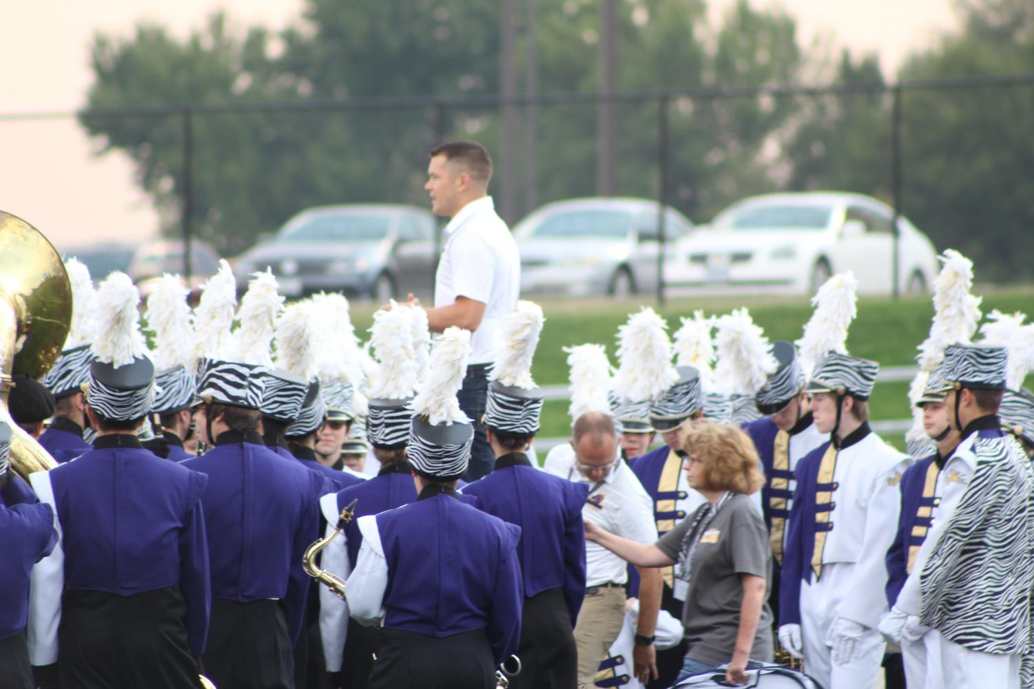 Jeffery Robilliard, Band Director, gives the varsity marching band a pep talk. Robilliard delivers one of these pep talks before every performance.