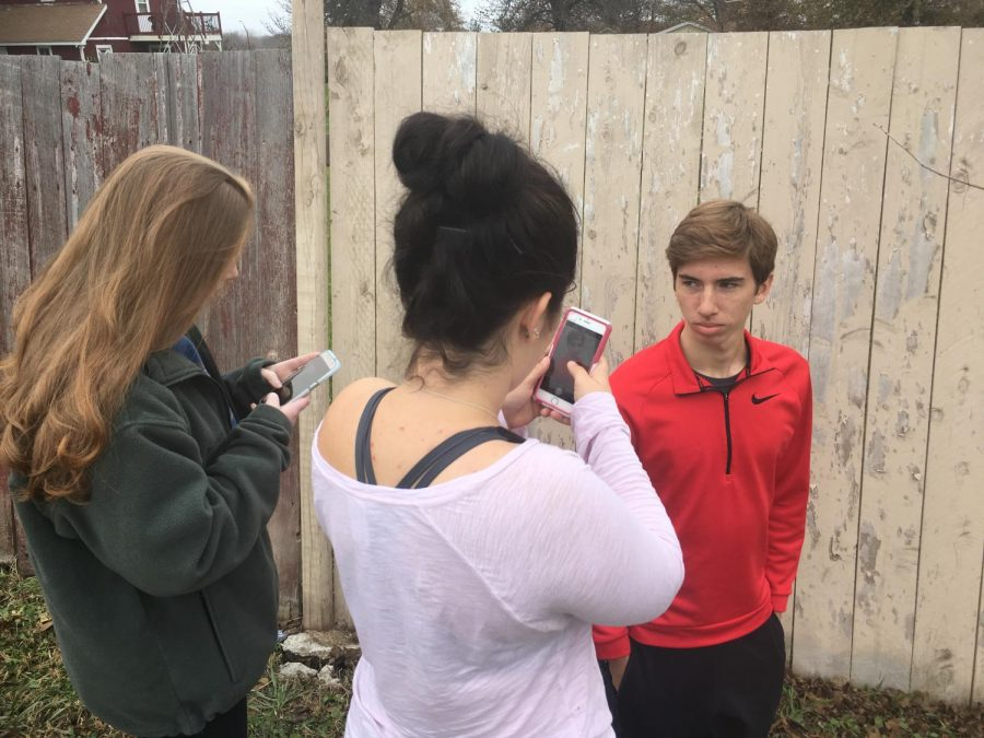 Katrina Feinberg '19 (left) and Jailyn Alderman '19 (right) take Aaron Koopal's '18 picture. The assignment in Digital Photo was to focus on the subject and convey a list of emotions. Koopal picked
