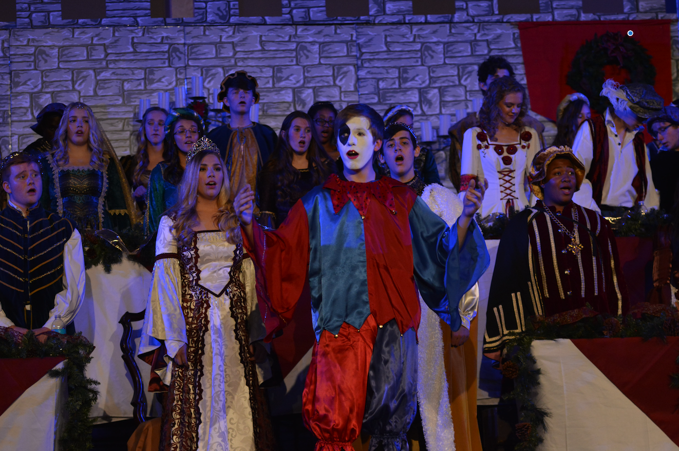 The seniors who make up the royal court perform at madrigal. Madrigal was held at The Bridge on Nov. 29 and 30.