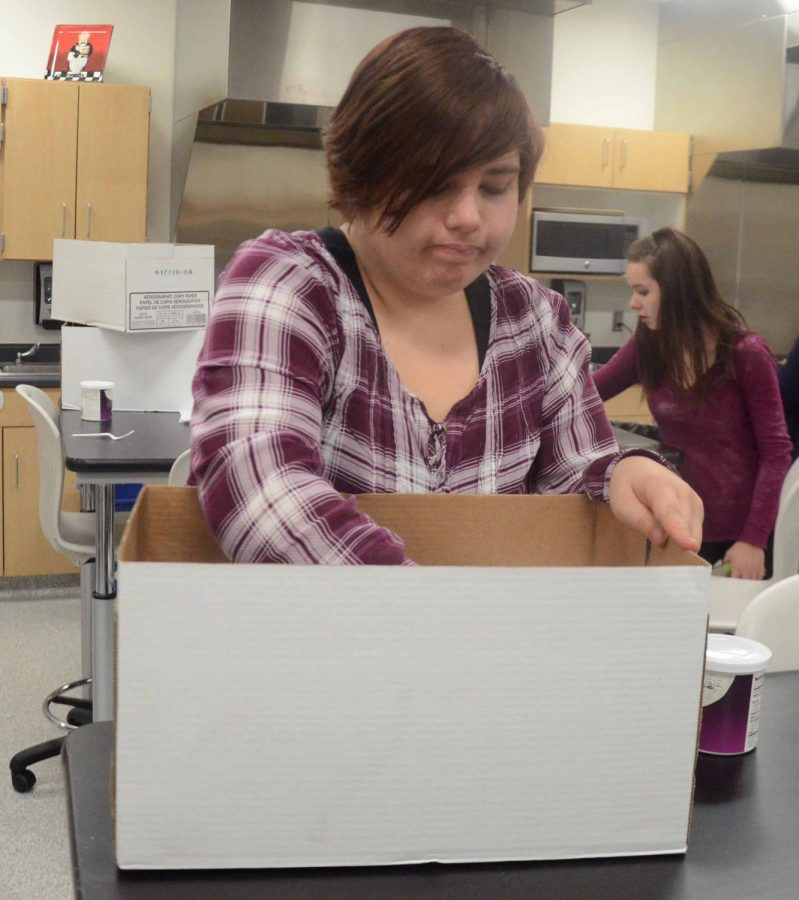 Cheyenne Stroeber 20 packs away her food to bring hope. Each student had enough dishes to fill the box with minimal extra room.