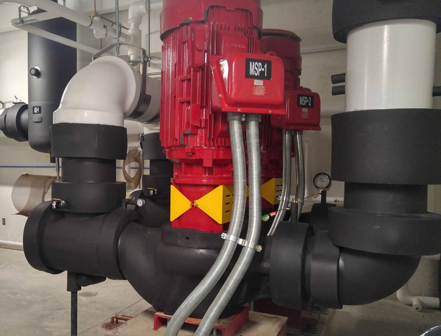 These are motors with 2000 horsepower that forces water through the pipes and around the building. Only one is working at each time, while the second is used as a backup.