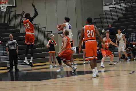 Boys' varsity basketball wins first home game