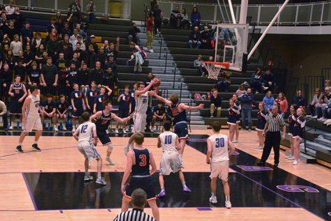 Boys' basketball beats Urbandale 66-51
