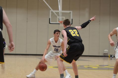 Boys' varsity basketball team beats Southeast Polk