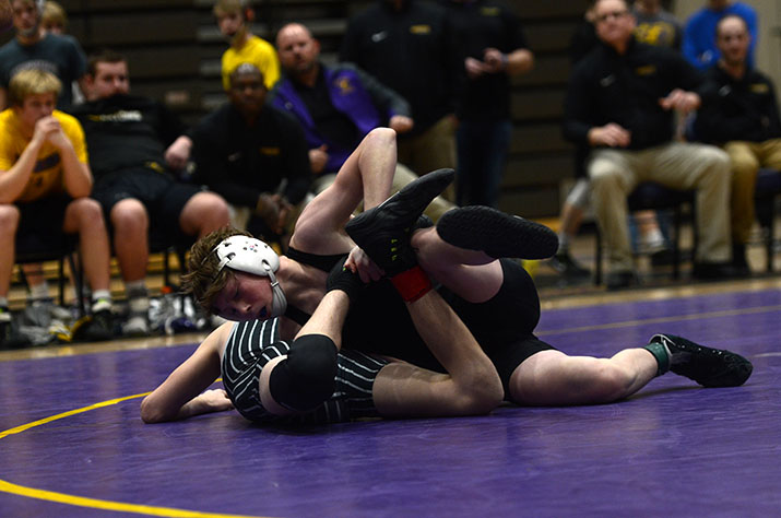 Caleb+Helgeson+%2721+grabs+the+ankle+of++opponent+Noah+Blubaugh.+Helgeson+won+the+match+with+a+12-4+Major+Desicion.