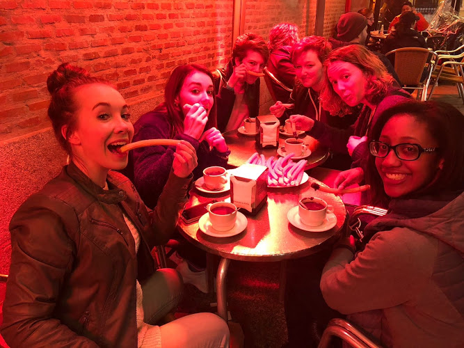 """Amber Altman, Bianca Leewright, Katherine Srail, Mackenzie Stanley, Grace Saliers and Kennedy Stone are seated, basking in the heated lamps on a cold night. """"We found this famous churros and chocolate place,"""" Mackenzie Stanley '19 said. """"The hot chocolate there is literally just melted chocolate, instead of milk, and we got these huge plates of churros that are stacked to the brim."""""""