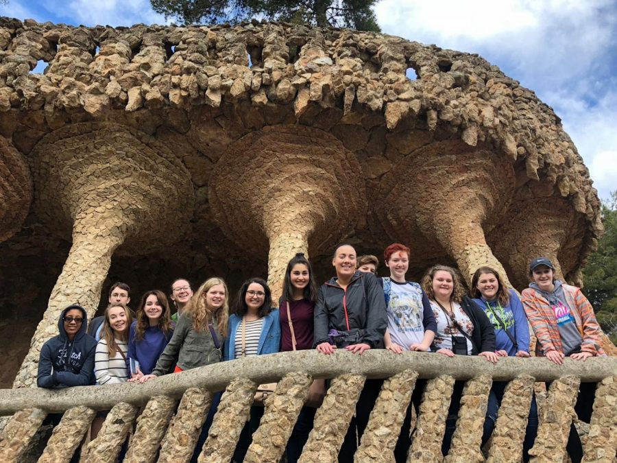 "Students stand for a group photo in front of elaborate architecture in Park Güell. ""It was such a beautiful place and it kept going on and on,"" Mackenzie Stanley '19 said. ""You were just like, there has to be an end to this park somewhere! But there wasn't [an end], you could just keep exploring."""