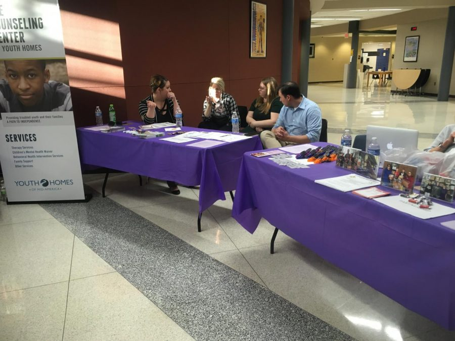 Iowa Youth Homes and Johnston Police Department's tables are right next to each other. They each have pens, chocolate, magnets, and lots of handouts for parents to take.