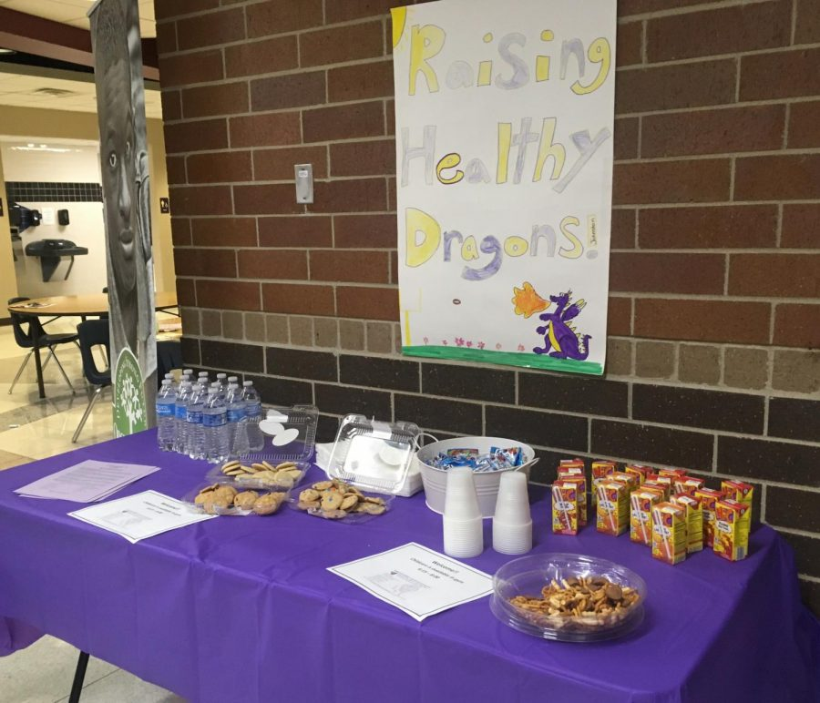 The snack bar has cookies, Chex mix, water bottles and juice boxes for parents to take. Summit students made posters for this event to provide directions.