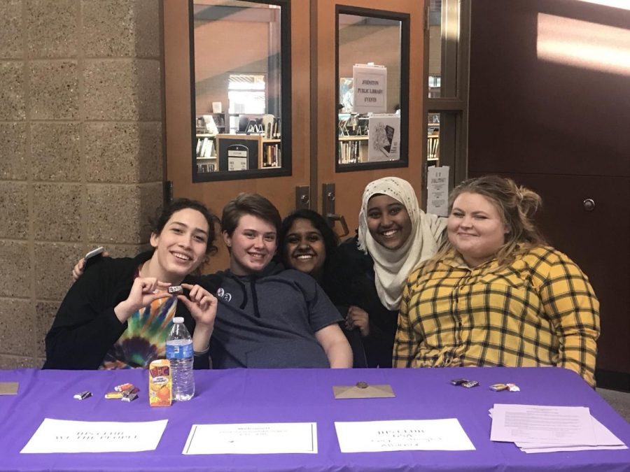 Grace Ballesteros '19, Elliot Fisher '19, Parul Srivastava '19, Obsee Abbajabal '19, Hannah Mitchell '18 set up the G.S.A., C.O.R.E. and We The People tables at the resource fair.