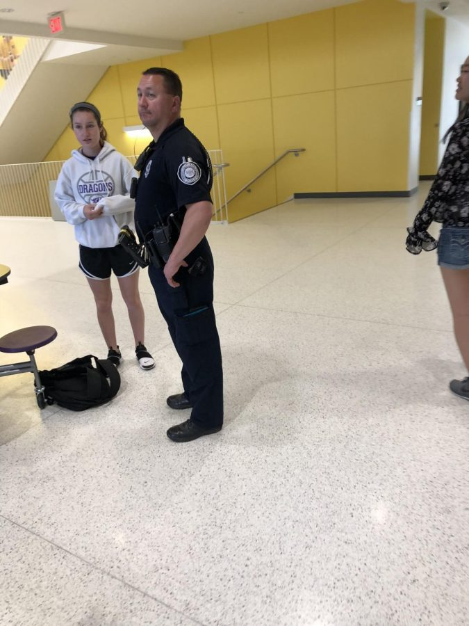 Officer Slack conversing with a student over lunch. Slack's job responsibilities include interacting with the  community and the public in non-enforcement interactions.