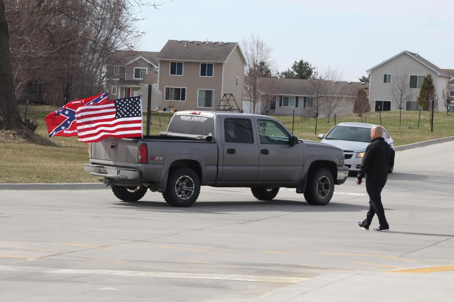 Principal Woods approaches a vehicle flying a confederate flag in the parking lot. Woods approached the vehicle during the April 20 walkout.