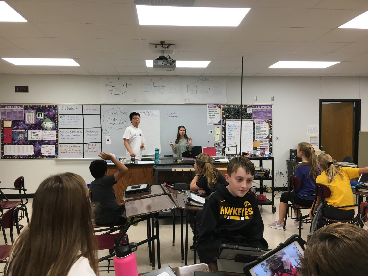 Matthew Ding '20 and Rachel Winkler '21 coach middle school Mock Trial students at their weekly practice. Ding and Winkler had to go through a selective application process due to the Silver Cord changes.