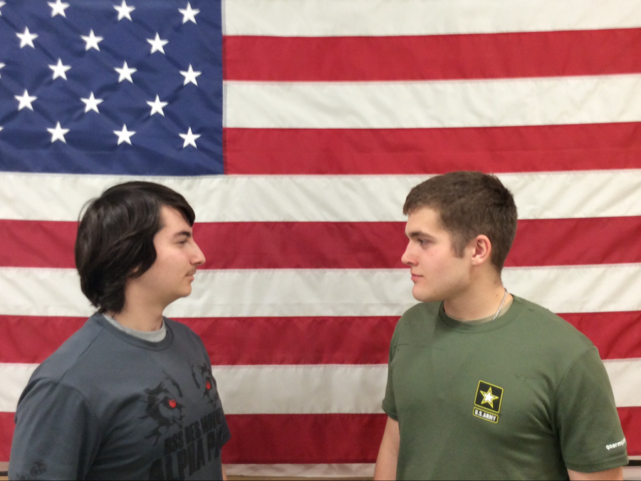 A marine and an army recruit face off in front of the American flag