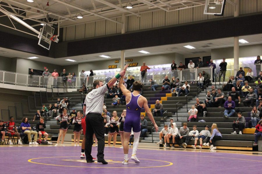 The+referee+raises+the+hand+of+Cade+Moss+%2719+to+show+that+he+won+his+match.+Moss+pinned+his+opponent+20+seconds+into+the+first+period.++