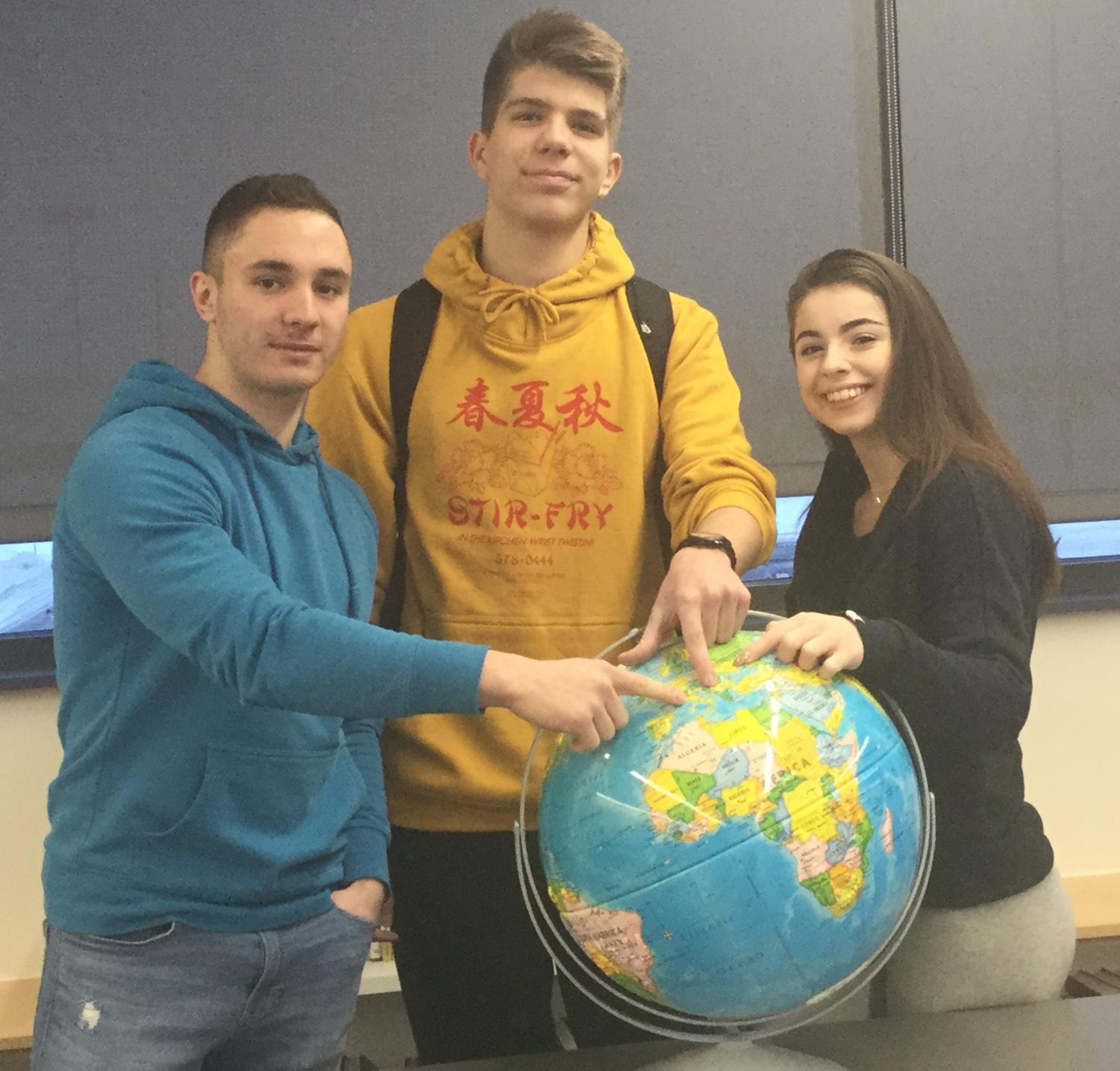 The three foreign exchange students at Johnston: Eduard Stancu from Italy, Aleksa Dogandzic from Serbia, and Anastasia Bilak from Ukraine.