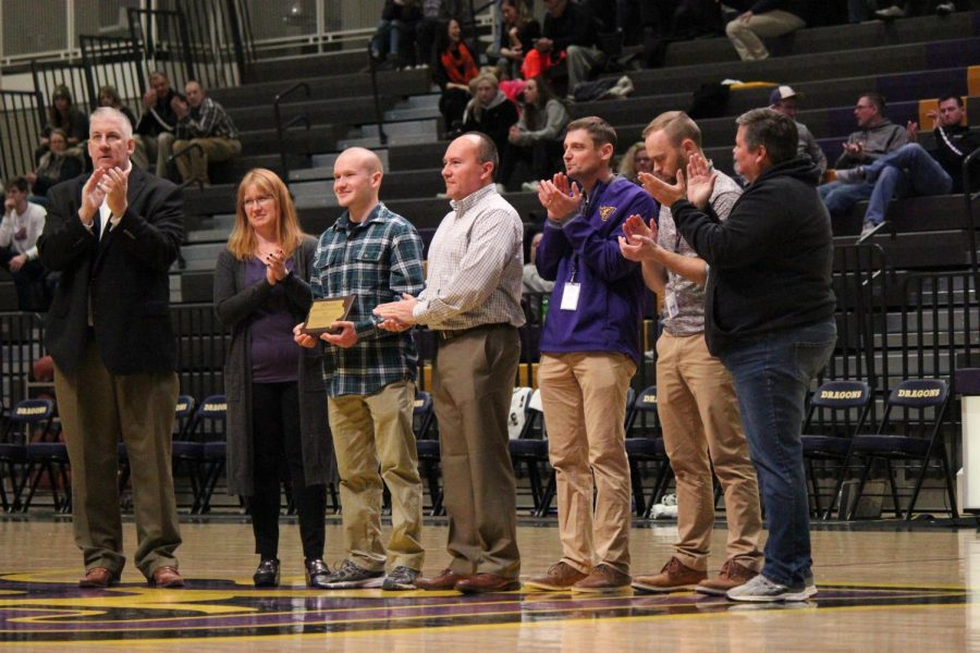 Micheal Schmitz '19 accepts the (figure out name of award) from athletics director Joe Nelson. Among the people with him are coaches of Micheal ,Shari Waling , Matthew Jaschen, and Patrick Mattingly