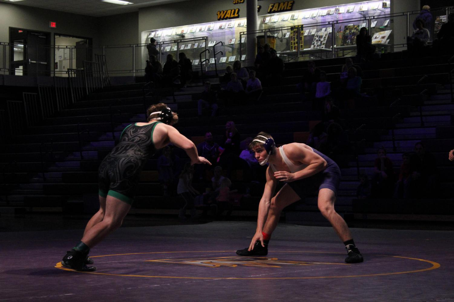 Tyler Christensen '19 and his opponent, North-Hoover's Dalton Davis, face off in neutral position. Christensen went on to win the match.