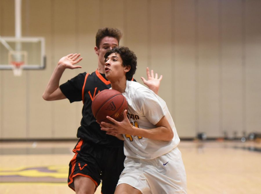 Jonathan Leth '20 drives to the hoop against Valley. Leth had three rebounds.