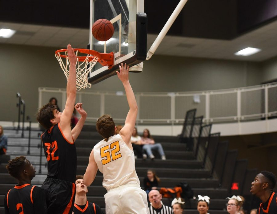 Max Roquet '21 shoots a layup against Valley. Roquet had five points in their loss.