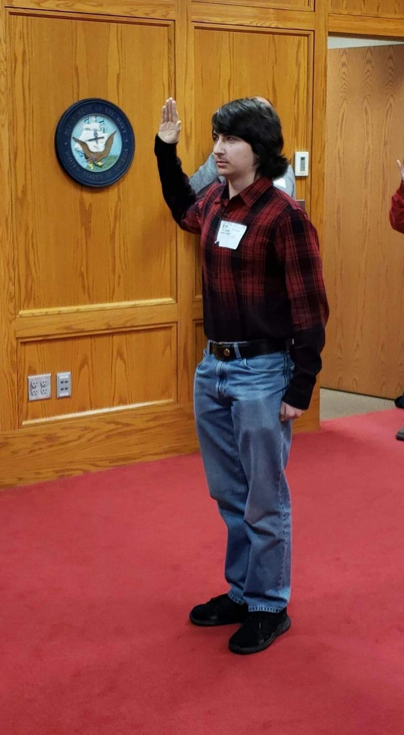 Connor Tomlinson taking the oath to swear into the USMC at Camp Dodge on Jan. 14., 2019