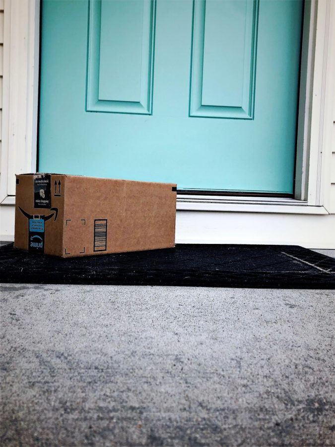 An Amazon package sits on the front step.