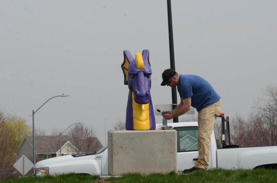 Two dragon heads were installed Tuesday on a roundabout and in front of the football stadium.