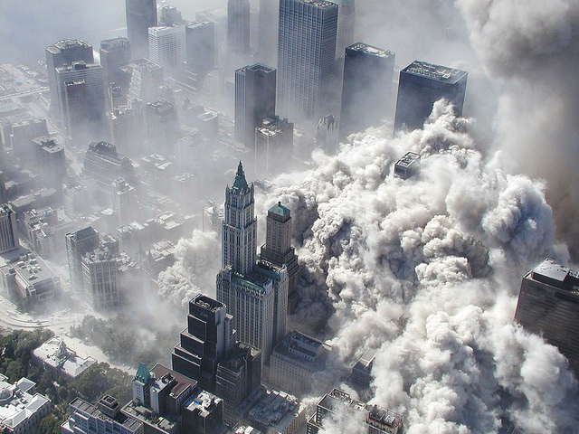 Smoke billows over the city of New York covering the majority of the buildings.