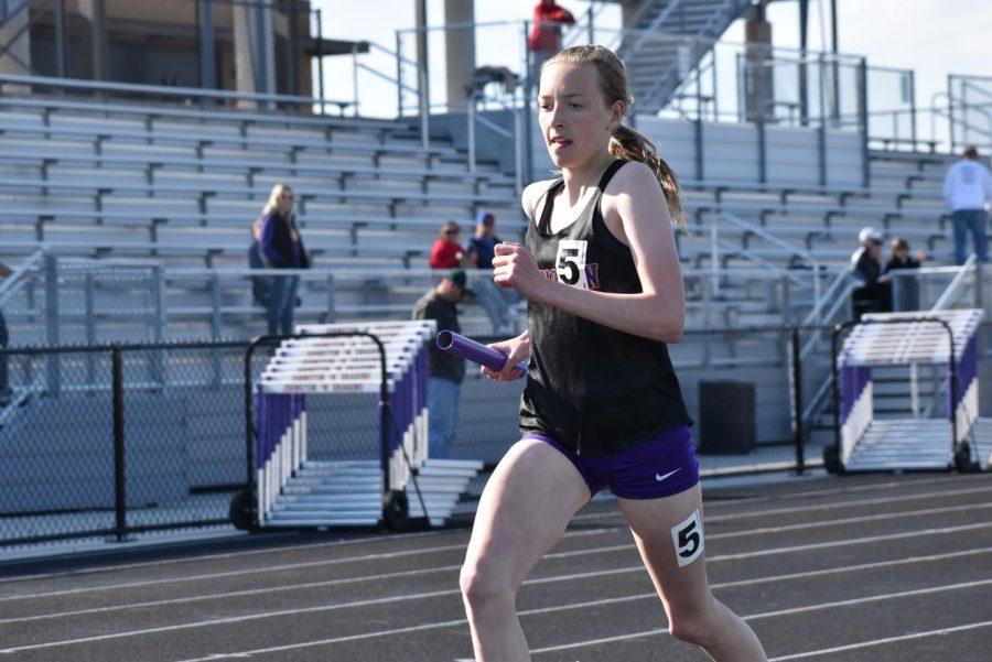 Sam Strauss 21 runs the 4x800 meter relay.