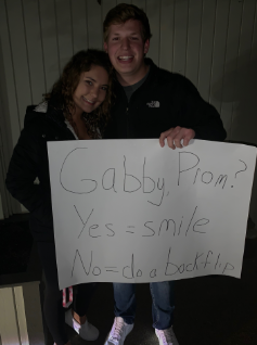 Riley+Sackett+%2719+with+his+date%2C+Valley+student+Gabby+Manna+%2719.+Sackett+asked+his+date+to+prom+with+this+sign.