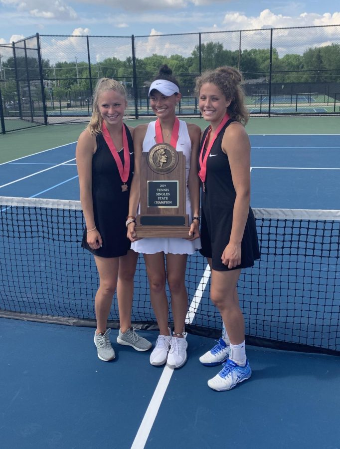 Julia Heil, Cari Naanep, and Dasha Svitashev display their trophy at state tennis in Bettendorf Thursday.