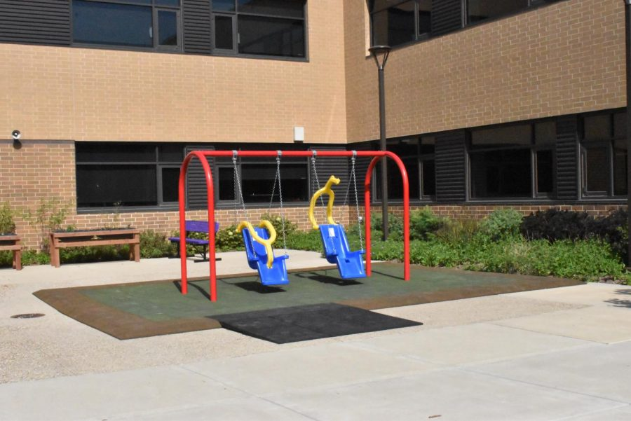 The empty special needs swing set sit in the middle courtyard, but where did they come from?