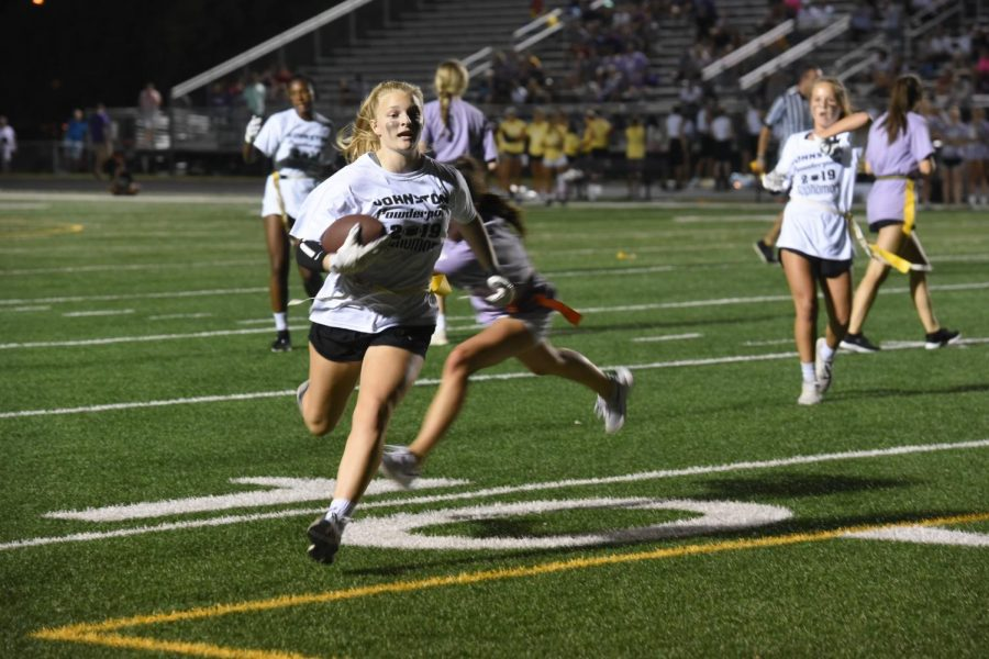 Anna Gossling '22 runs the ball past defenders and the 10 yard line to get her team the first down.